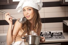 Sexy housewife tasting Royalty Free Stock Photos