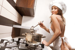 Sexy housewife tasting Royalty Free Stock Photo