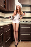 Sexy housewife tasting Stock Photography