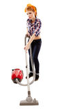 Sexy housewife vacuuming. Full length studio shot of sexy housewife vacuuming, isolated over white background Stock Photography
