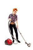 Sexy housewife vacuuming Stock Photo