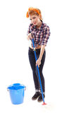 Sexy housewife washing the floor with a mop Stock Photography