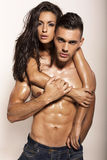 impassioned couple posing in studio Royalty Free Stock Images