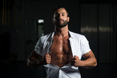Sexy Italian Man Posing In White Shirt Stock Images