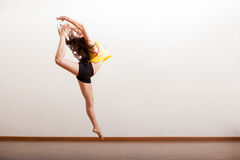 Sexy jazz dancer performing a jump Royalty Free Stock Image