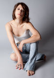 Sexy in Jeans. An image of a model in bare feet and ripped jeans Stock Photo