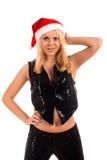 jonge blonde vrouw in de hoed van de Kerstman Stock Afbeelding