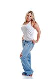 jonge vrouw met gescheurde jeans Stock Afbeelding