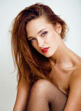 Sexy jonge vrouw in zwarte nylonkousen en lingerie Royalty-vrije Stock Foto's