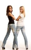 Sexy jonge vrouwen in nauwsluitende jeans stock afbeeldingen