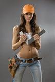Sexy jonge vrouwenbouwvakker Stock Afbeelding