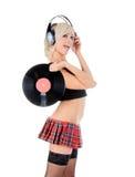 Sexy junges Mädchen, das mit Vinylscheibe aufwirft Stockfotos