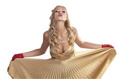 Sexy Kerstmismeisje dat een kus blaast Royalty-vrije Stock Foto's