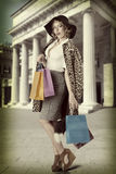 Sexy kitsch girl with  shopping bag vintage Royalty Free Stock Images