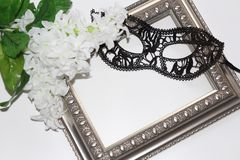 Sexy lace eye mask for woman and vintage frame. White background stock photos