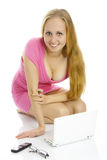 Sexy lade sitting near laptop. Royalty Free Stock Photo