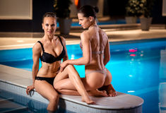 Sexy ladies posing near pool Stock Image