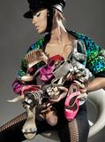 Sexy lady. Holding many pairs of shoes Royalty Free Stock Images