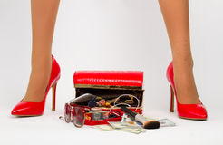 Sexy lady. Accessories scattered from a handbag  between the woman's legs. Sexy lady Stock Photography