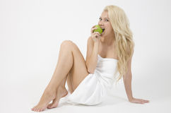 Sexy lady with an apple Royalty Free Stock Photos