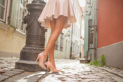 Sexy lady with beautiful legs walking in old town Stock Images