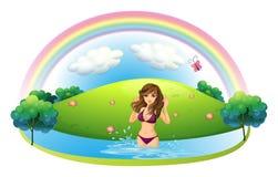 A lady in bikini at the beach Stock Image