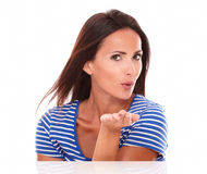 Sexy lady in blue t-shirt blowing a kiss Royalty Free Stock Images