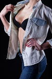 Sexy lady in bra and jeans shirt Stock Photography