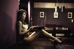 Sexy lady browsing internet Royalty Free Stock Photography