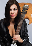 Sexy lady with a guitar Royalty Free Stock Image