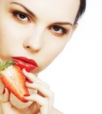 Sexy lady holding a juicy strawberry Stock Photos