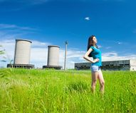 lady in an industrial background Royalty Free Stock Image