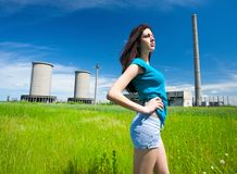 lady in an industrial background Stock Images