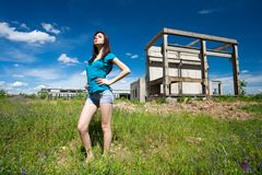 lady in an industrial background Stock Image