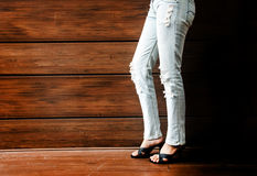 Sexy lady leg with jeans at bar at night club for background. Grain photo of sexy lady leg with jeans at bar at night club for background Royalty Free Stock Images