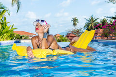 lady with long legs at the pool. Stock Image