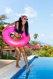 lady with long legs at the pool. Royalty Free Stock Photography
