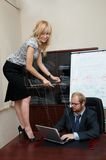 Sexy Lady manipulates a Boss Stock Photography