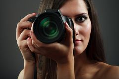 Sexy lady photographer Stock Images