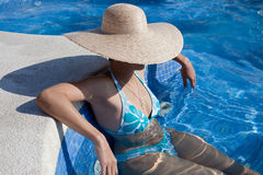 Sexy lady in the pool Royalty Free Stock Images