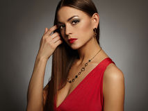 Sexy lady in red dress. Beautiful sexy woman wearing jewelry.lady in red dress Stock Photo