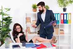 Sexy lady relax at table on workplace. glamour office life. ceo man angry on naughty girl. business relations. business