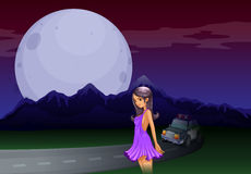A sexy lady at the road in the middle of the night Royalty Free Stock Images