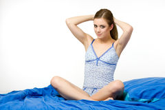 Sexy lady sitting in the bed Stock Images