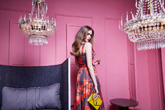 Sexy lady wear clothes office style casual meeting party cotton. Dress red color accessory bag jewelry cosmetic face makeup beautiful woman in interior design Royalty Free Stock Photography