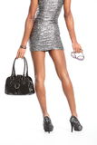 Sexy lange benen van mannequin in zilveren kleding Stock Foto's
