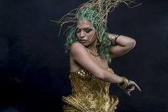 Sexy Latin woman with green hair and gold costume with handmade Royalty Free Stock Photography