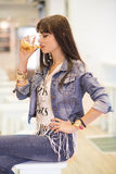 Sexy latina woman drinking in bar Royalty Free Stock Photo