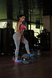 Sexy Latino Woman Resting After Workout In Gym Stock Photo