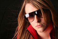 Sexy laura. Young model wearing shades and ski jacket Royalty Free Stock Image